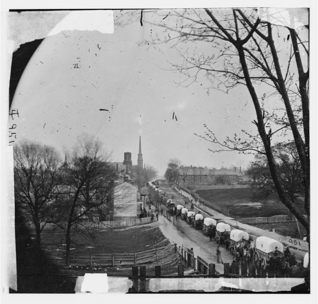 A Federal wagon train entering Petersburg, Virginia in April 1865.  This image provides an idea of the trains that would have accompanied the 6th Corps.  LC