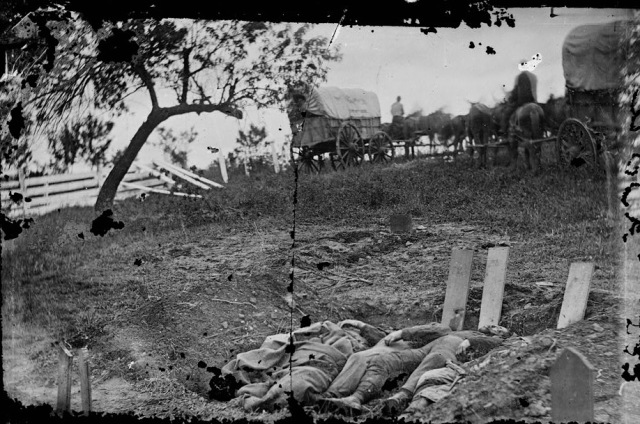 One of the series of images captured by Gardner's team.  These are Confederate dead of Kershaw's brigade who their comrades had prepared for burial but had to abandon when they were withdrawn to Warfield Ridge.  LC
